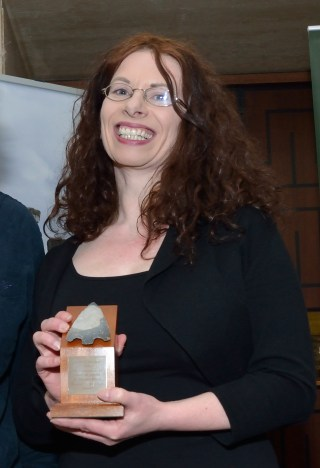 Marion Dowd with her award for Book of the Year 2016. Aerial-Cam / Current Archaeology