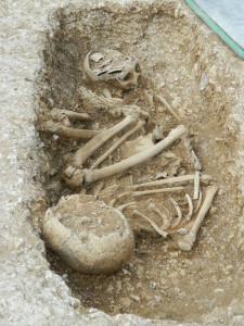 One of the site's double-burials: a child grave containing two skeletons poignantly arranged 'top to tail' as if in bed.