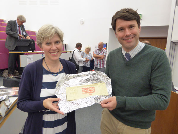 Dr Rebecca Jones presents CA editor Matt Symonds a chocolate replica of the Roman distance slab from Bridgeness