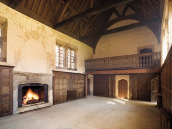 Guy Wolston built the first house at Apethorpe in 1470-1490. This elaborately traceried door formed the main entrance to his Great Hall. Inside this space we can see the original door on the right, and a 16th-century fireplace on the left that replaced the original open hearth. The windows set high in the long walls are of a type employed in brick at Eton College and Queens' College, Cambridge, showing that Wolston's builders were abreast of recent trends.