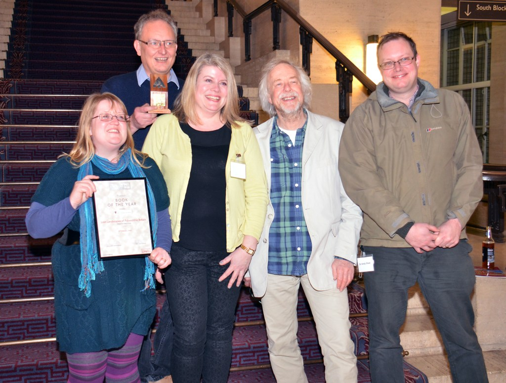 Mark White, winner of Book of the Year 2018, holds with his award, along side colleagues and the award presenter Julian Richards [Photo Credit: Current Archaeology]