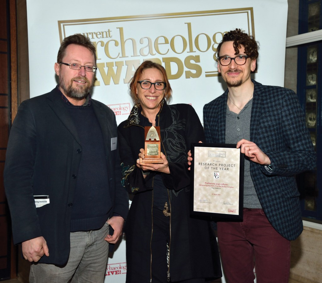 Members of the team behind the Bell Beaker DNA project collect their award for Research Project of the Year 2019, at the Current Archaeology Awards.