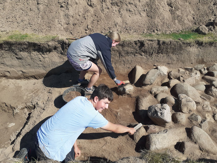Two of the local community volunteers who helped excavate the roundhouse at Dinas Dinlle.