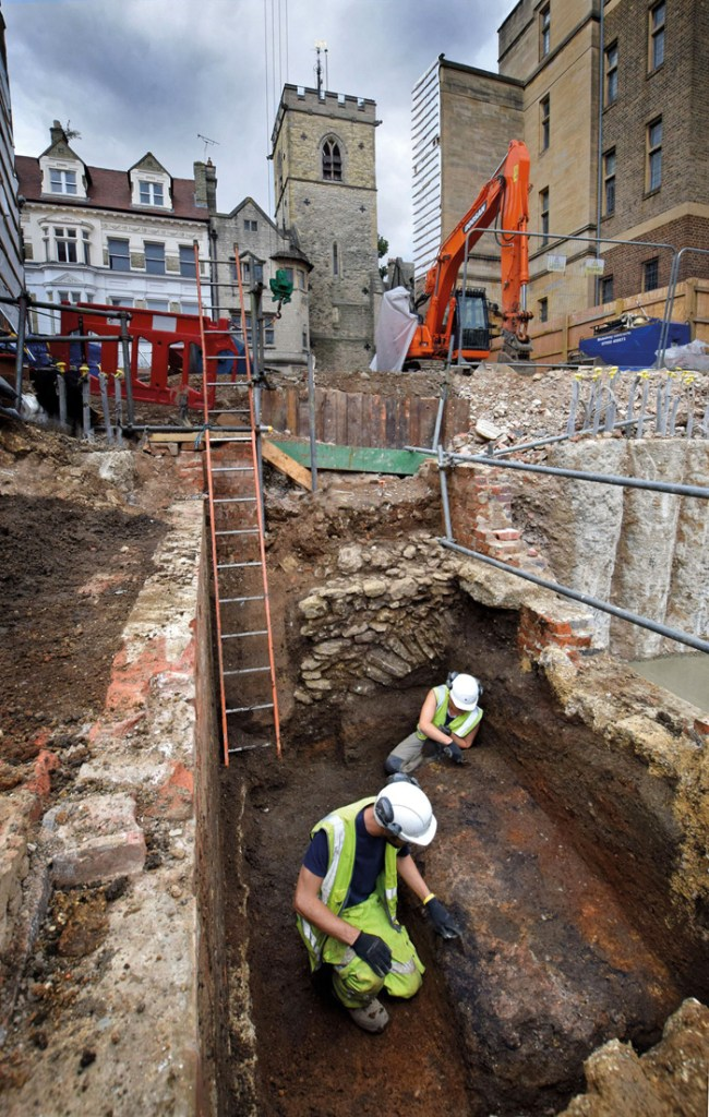 Excavations on the corner of Queen Street and St Aldates, in Oxford city centre. In the background is Carfax Tower.