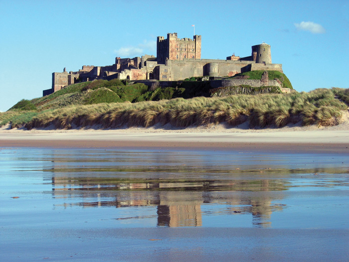 View of Bamburgh castle and the sand dunes in front of it