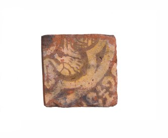A square brick tile with decoration