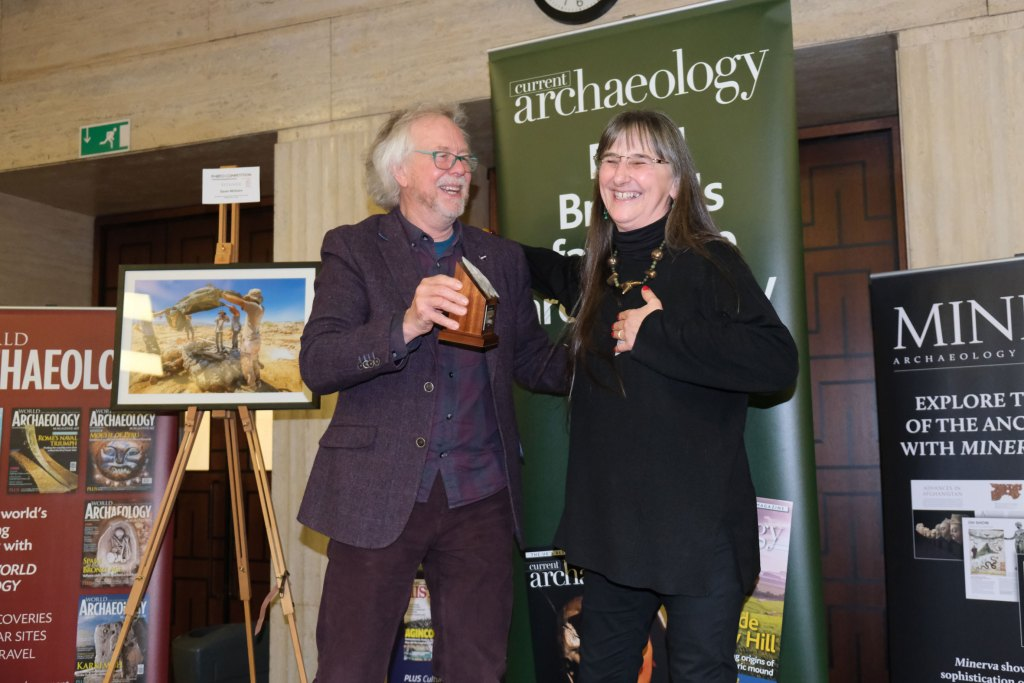 Julian Richards presents Alison Sheridan with the award for Archaeologist of the Year 2020 at the Current Archaeology Awards.