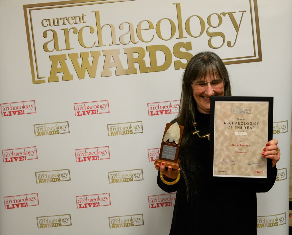 Alison Sheridan collects the award for Archaeologist of the Year 2020 at the Current Archaeology Awards. [Photo credit: Adam Stanford, Aerial-Cam]