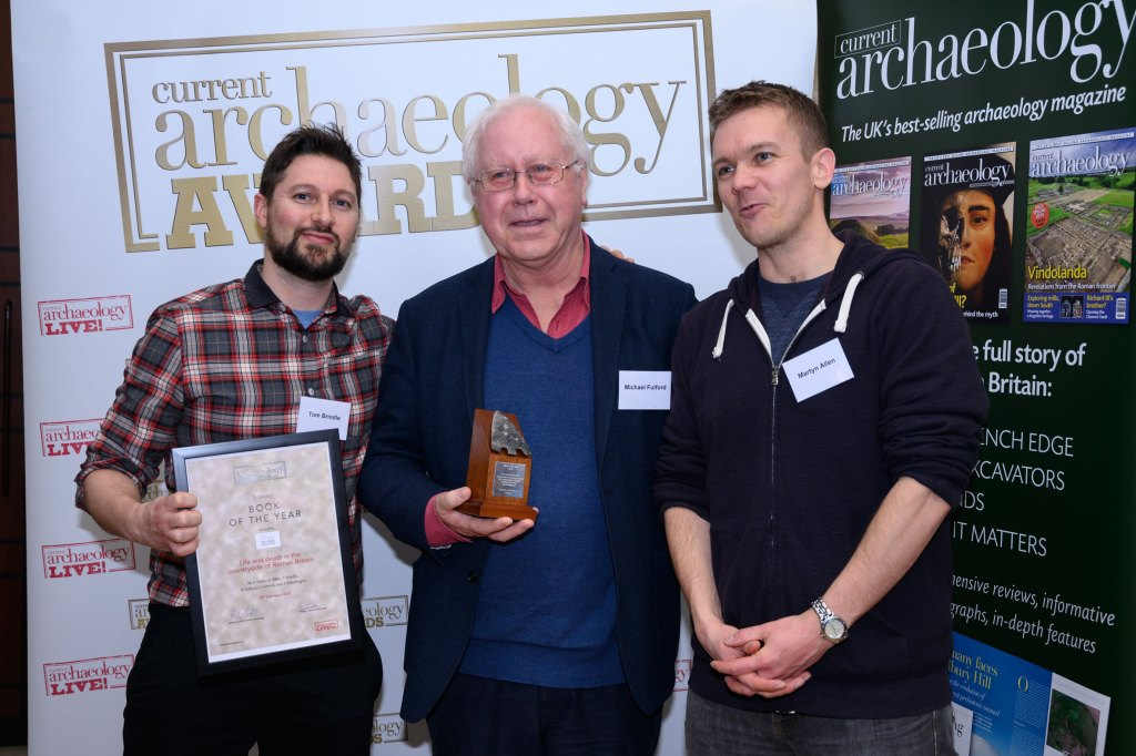 Tom Brindle, Michael Fulford, and Martyn Allen (l-r), some of the author of Life and death in the countryside of Roman Britain, collect the award for Book of the Year 2020 at the Current Archaeology Awards.