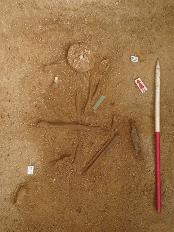 The burial in the ground during excavation
