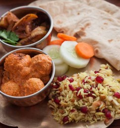 everyday meal plate kashmiri dum aloo apple baingan pulao phulka 1 [ 1300 x 867 Pixel ]