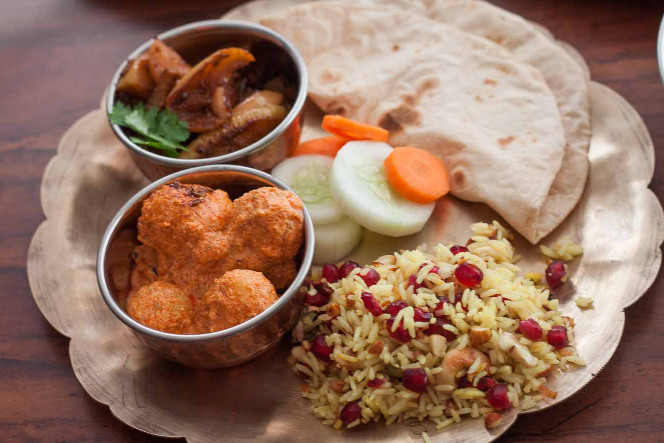 hight resolution of everyday meal plate kashmiri dum aloo apple baingan pulao phulka 1