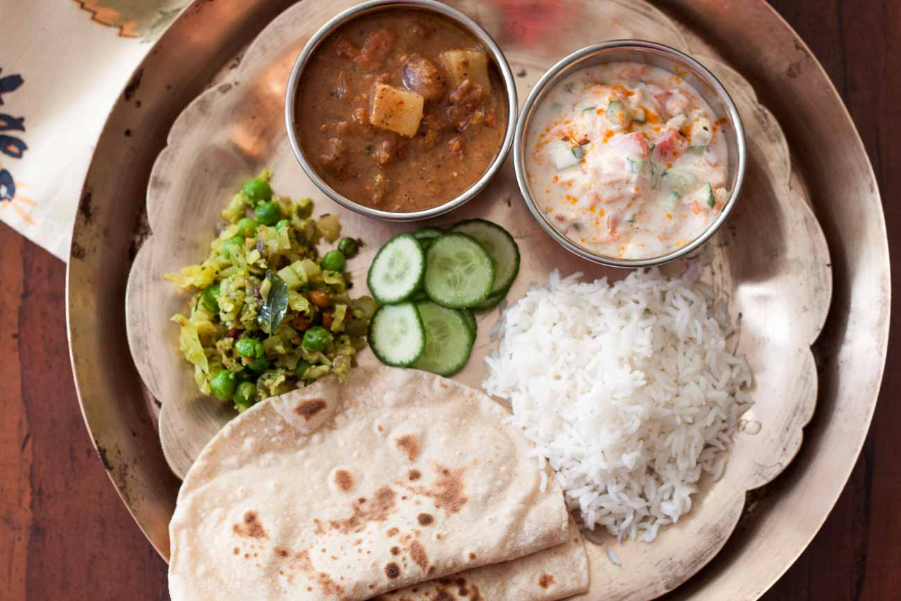 hight resolution of lunch plate ellu kuzhambu cabbage thoran roti tadka raita 2
