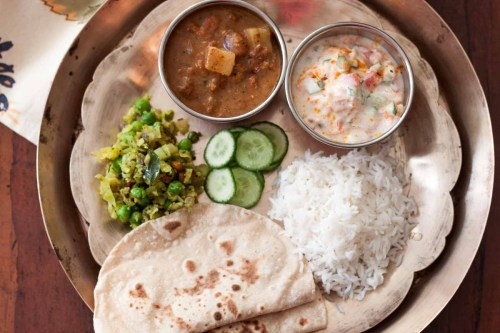 small resolution of lunch plate ellu kuzhambu cabbage thoran roti tadka raita 2