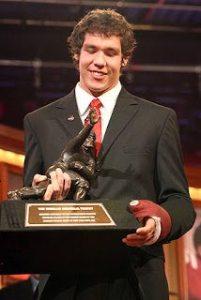 Bradford accepting the Heisman Trophy.
