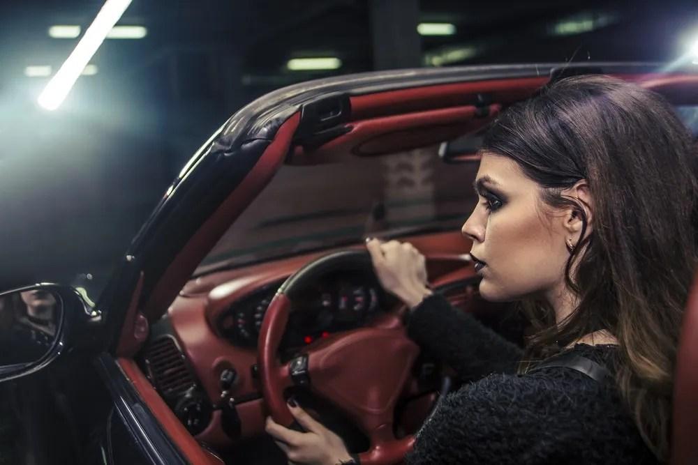 Woman in Luxury Car