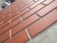 Clay brick tiles create heritage facade on precast ...