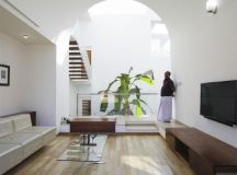 The Running Wall Residence by LIJO RENY Architects in ...