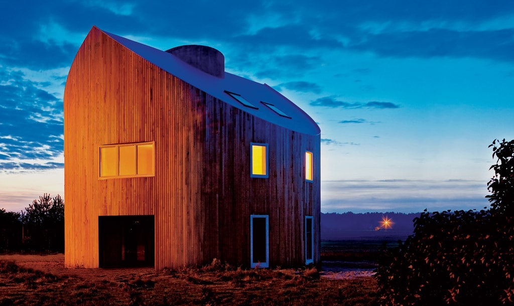 maison bois ronde et bioclimatique au nuit