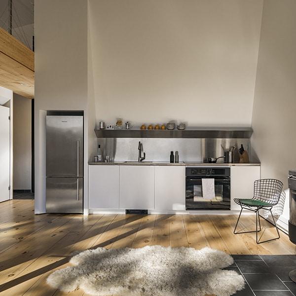 cuisine ouverte blanche dans maison bois