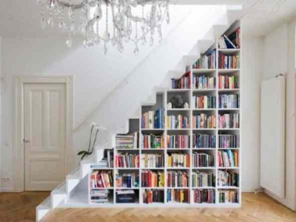bookshelves under the stairway