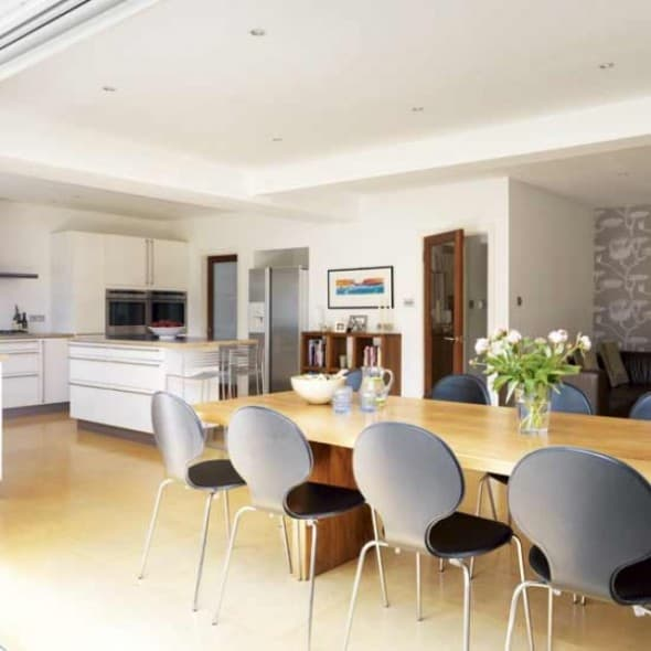 large dining room with kitchen as the adjacent spaces
