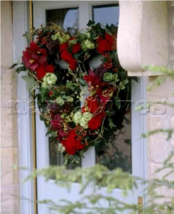 traditional Christmas wreath with red flowers mounted