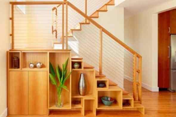 vase rack under stairway