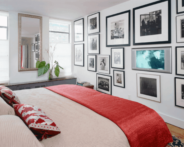 Modern bedroom with several framing posters in one of the bedroom wall