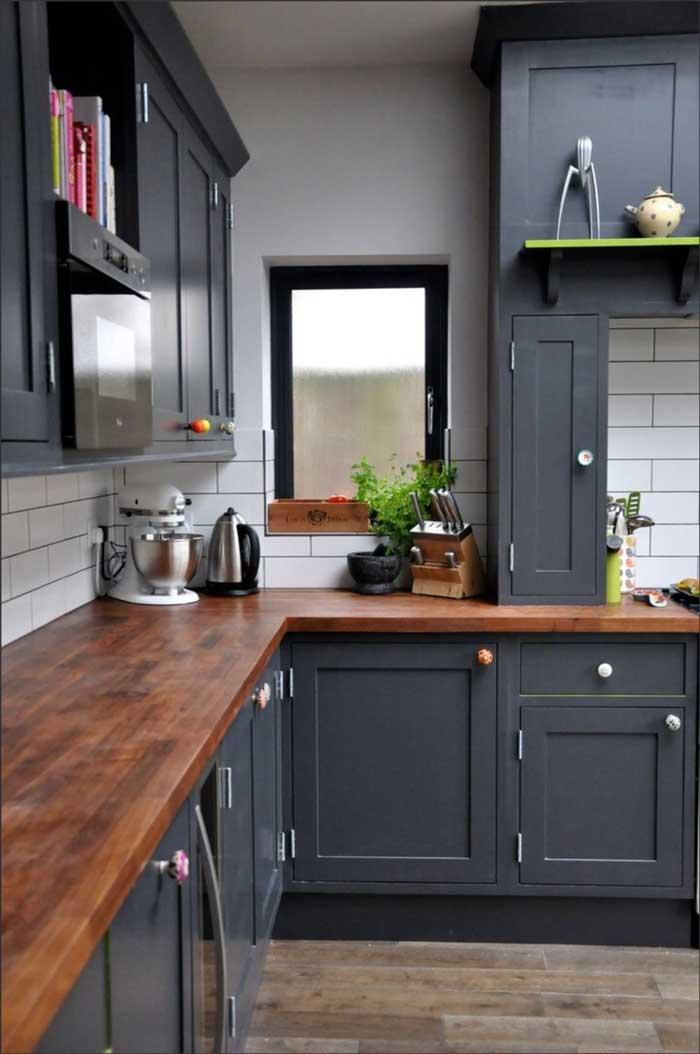 wood countertops kitchen overstock sinks 10 hidden benefits of butcher block paired with dark blue painted cabinets