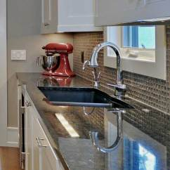 Best Granite Colors For Living Room India Ideas Uk Grey 10 Delightful Countertop With Names And Pictures Brown Pearl Counters Polished To A Highly Refelective Surface Glass Tile Backsplash