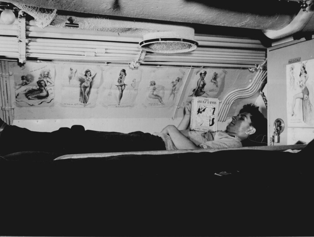 medium resolution of sailor reading in his bunk aboard uss capelin at submarine