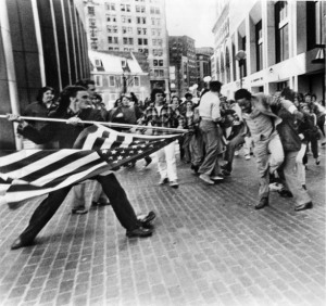 "Soiling of Old Glory"" depicting Joseph Rakes assaulting Ted Landsmark, a civil rights activist and lawyer, at Boston City Hall.  Photo credit to Stanley Forman/Boston Herald."