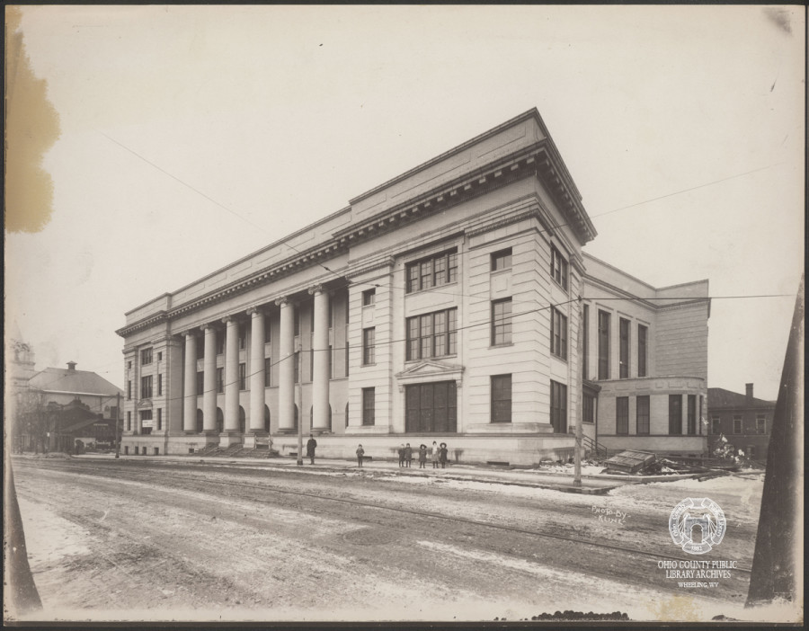 "The new Wheeling High School opened its doors to the public May 29th, 1911. This photo, taken near the completion date of its construction by photographer C. C. Kline, shows a banner strung up in the far set of windows, that under magnification reads ""Hiener Hardware,"" a local hardware company that was located on 1301-1303 Market St. Hoffman Collection, OCPL Archives."