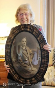 Roberta Lee Mitchell holds the portrait of her cousin.