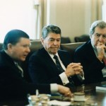 President_Ronald_Reagan_receives_the_Tower_Commission_Report_with_John_Tower_and_Edmund_Muskie