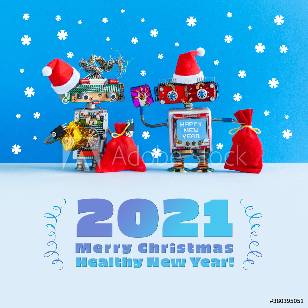 Merry Christmas Healthy 2021 New Year festive poster. A funny kind postcard with two robots Santa Claus dressed in red Santa hats and bags with Xmas gifts. Snowfall on blue background.