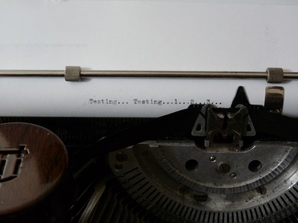 "Antique typewriter with typed words, ""Testing...testing... 1... 2... 3..."""