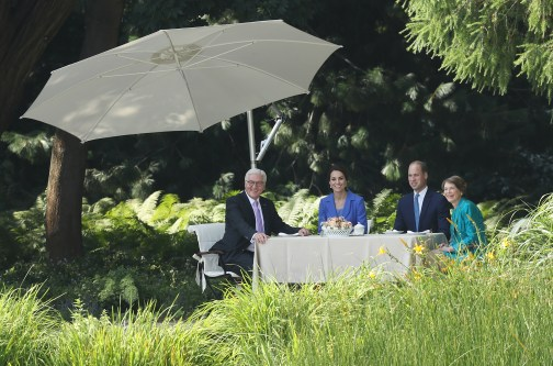 BERLIN, GERMANY - JULY 19: Catherine, Duchess of Cambridge (C-L), and Prince William, Duke of Cambridge (C-R), sit down with German President Frank-Walter Steinmeier and Fist Lady Elke Buedenbender in the gardens of Schloss Bellevue presidential palace on the first day of the royal visit to Germany on July 19, 2017 in Berlin, Germany. The royal couple are on a three-day trip to Germany that includes visits to Berlin, Hamburg and Heidelberg. (Photo by Sean Gallup/Getty Images)