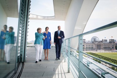 "This handout picture released on July 19, 2017 shows Britain's Prince William, Duke of Cambridge (R) and his wife Kate, the Duchess of Cambridge (C) on the terrace of the Chancellery in Berlin during a meeting with German Chancellor Angela Merkel. The British royal couple is on a three-day visit in Germany. / AFP PHOTO / Bundesregierung / Guido Bergmann / RESTRICTED TO EDITORIAL USE - MANDATORY CREDIT ""AFP PHOTO / BUNDESREGIERUNG"" - NO MARKETING NO ADVERTISING CAMPAIGNS - DISTRIBUTED AS A SERVICE TO CLIENTS == NO ARCHIVE GUIDO BERGMANN/AFP/Getty Images"