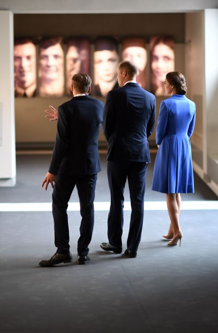 Britain's Prince William (C), Duke of Cambridge, and his wife Kate, the Duchess of Cambridge listen to explanations byUwe Neumaerker (L), the director of the Memorial foundation, as they visit the Museum of the Holocaust Memorial in Berlin on July 19, 2017. The British royal couple is on a three-day-visit in Germany. / AFP PHOTO / POOL / Bernd von JutrczenkaBERND VON JUTRCZENKA/AFP/Getty Images