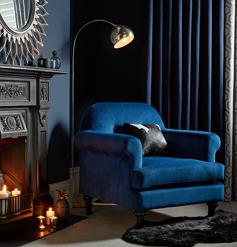 chair gym argos small office with arms midnight opulence home decor a cobalt blue accent sits in front of black painted fireplace chrome reading