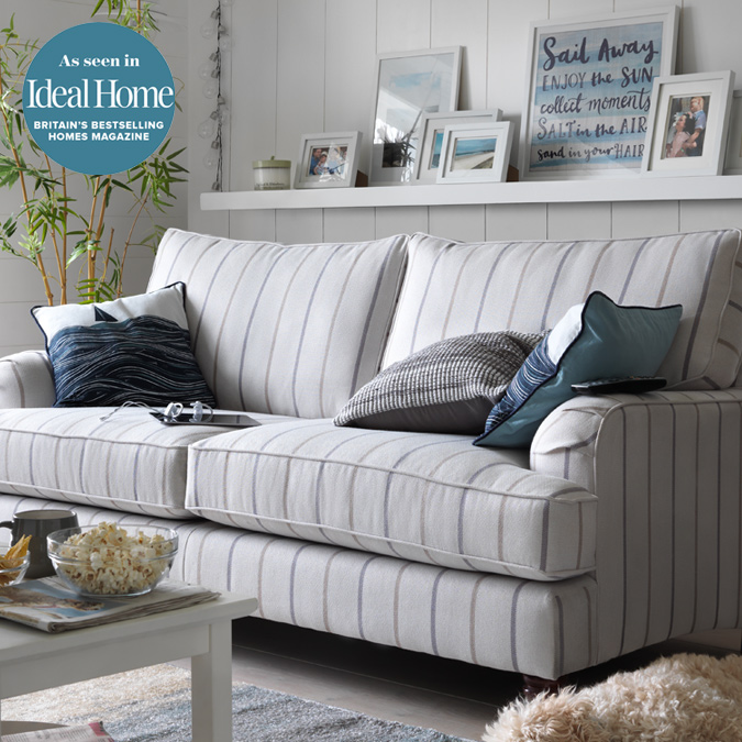 blue striped sofa uk metal ben til sofabord nautical decor argos beach house lounge featuring cream and stripe coastal themed cushions throws