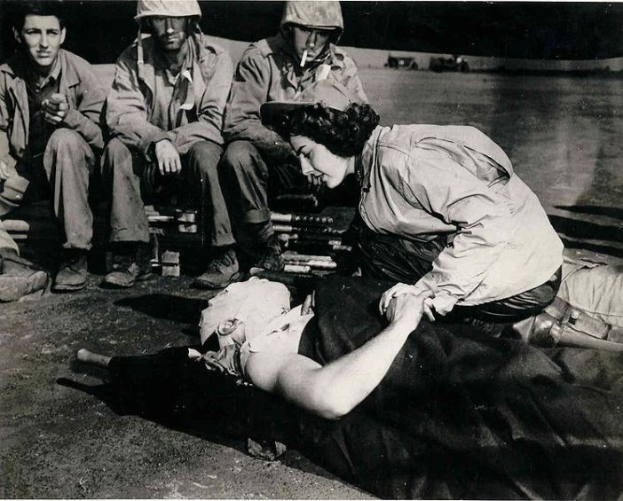 Flight nurse Jane Kendeigh, US Navy, caring for wounded Marine, William J Wycoff on Iwo Jima, March 3, 1945