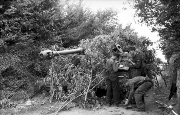 "France near Villers-Bocage, a Tiger Tank crew camouflages its Panzer, SS-Leibstandarte ""Adolf Hitler"""