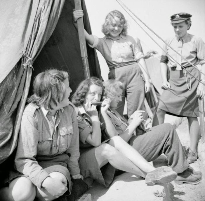 Female German Luftwaffe POWs at Camp Vilvoorde. The camp was managed by British forces of the 21st Army Group and housed over 12,000 Axis POWs, both men and women. Vilvoorde, Flemish Brabant, Belgium. June 1945. Image taken by Lt. O'Brien, No. 5 Army Film & Photographic Unit.