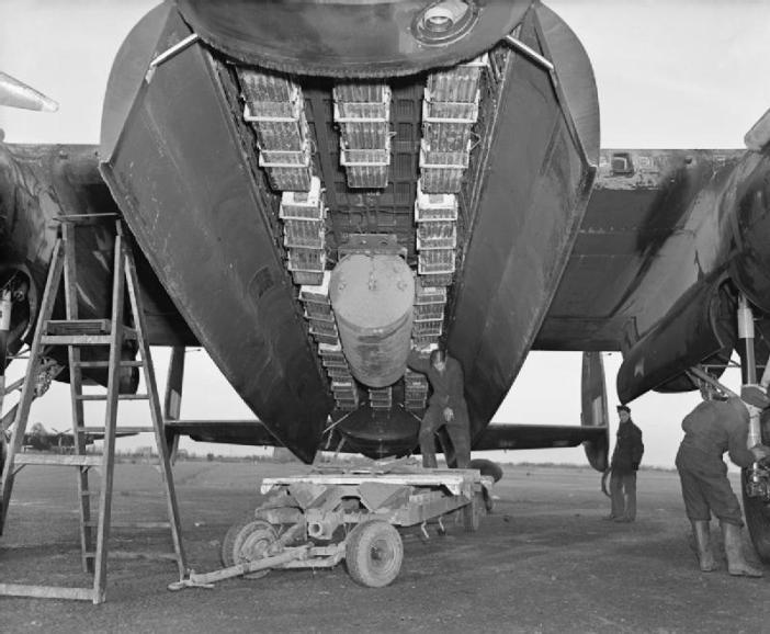 The bomb load most commonly used for area bombing raids (Bomber Command executive codeword 'Usual') in the bomb bay of an Avro Lancaster of No. 57 Squadron RAF at Scampton Lincolnshire. 'Usual' consisted of a 4,000 impact-fused HC bomb ('cookie'), and 12 Small Bomb Containers (SBCs) each loaded with incendiaries, in this case, 236 x 4-lb incendiary sticks.