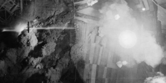 Vertical photograph taken during the night attack on the German tank and lorry depot near Mailly-le-Camp, France, by 346 Avro Lancasters of Nos. 1 and 5 Groups. A Lancaster, silhouetted by the large explosion, clears the target area during the raid which, although successful in the destruction caused, was costly in terms of aircraft losses, 42 being shot down by Luftwaffe night fighters.