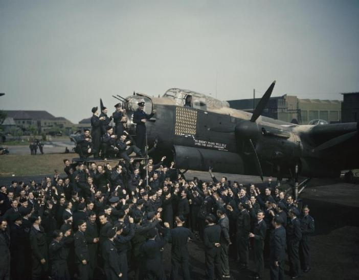 Aircrew and ground staff of No. 467 Squadron, RAAF at RAF Waddington, UK, celebrate the completion of 100 operations by the Avro Lancaster R5868 'S for Sugar' after its sortie on 11 - 12 May 1944 to a communications target in Belgium.