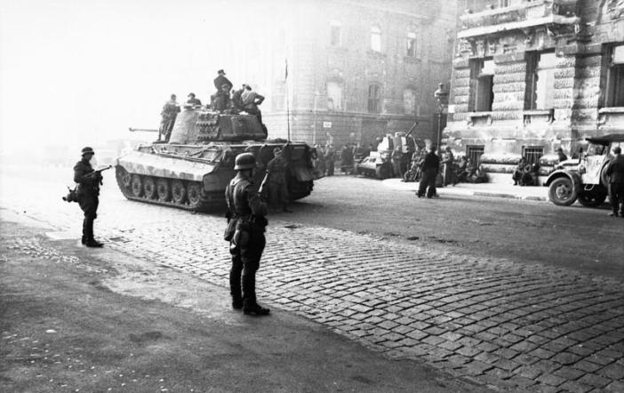 A Tiger II of the schwere Panzer-Abteilung 503 in the streets of Budapest.